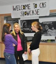 Jenn Kirk, CAS Coordinator, Sturgis West (r) Welcomes Families to CAS Showcase