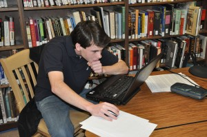 Joey Benedict Works on his Extended Essay