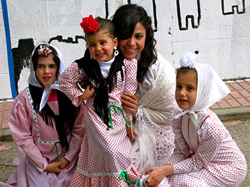 Christina Alvarez with her students during the San Isidro Festival.