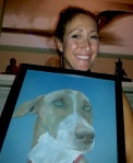 Xanthippi Abel with her charcoal drawing of Happy Dog, a street dog Chris took care of in the Dominican Republic