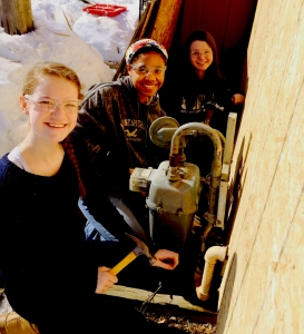 Claire Gilliland ('15), Taylor White ('15), and Sara Booth ('15) work on applying OSB before siding Stephanie's home