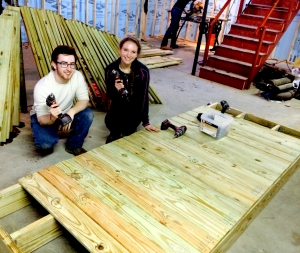 Chris Cifello ('14) and Julia Marquette ('15) work to build a wheel chair ramp for Stephanie's home