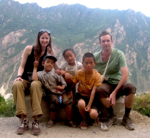 John and Christine meeting some locals on a hiking trip in Yunnan, China