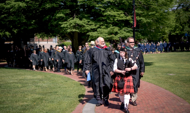 Maura Coughlin, Class of 2016, leads the procession of Sturgis East faculty and seniors through Hyannis Village Green to Hyannis Harbor for the 2015 graduation ceremony on May 30.