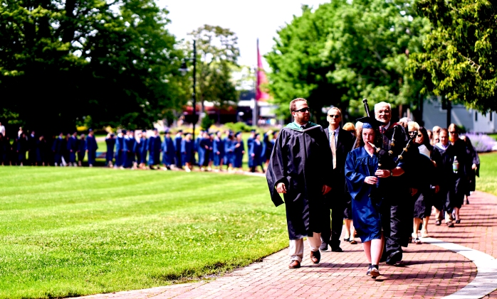 Maura Coughlin, Class of 2016, leads the procession of Sturgis East faculty and seniors through Hyannis Village Green to Hyannis Harbor for the 2016 graduation ceremony on June 4.
