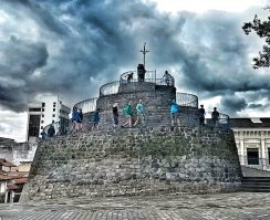 Climbing a monument in Quito